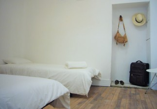 Twin room with wooden floors